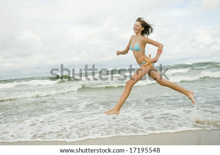 Young girl with starfish on the beach