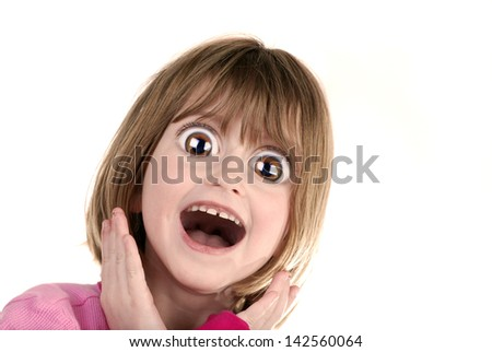 Young girl with surprised look holding hands on face - stock photo