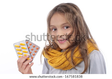 Young girl with tablets