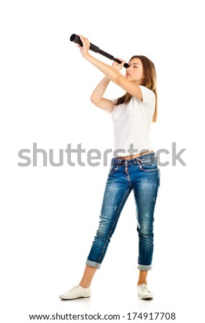 young girl with telescope isolated on a white background - stock photo