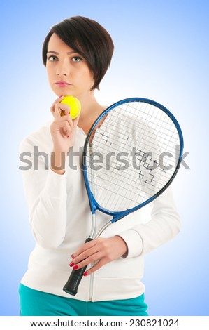 Young girl with tennis racket and bal isolated on white