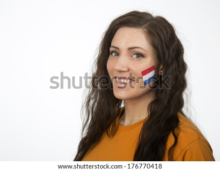 Young Girl with the Dutch flag painted in her face - stock photo