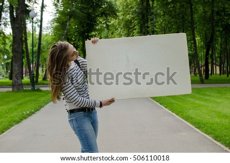Young girl with the white banner in the city