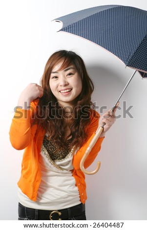 young girl with umbrella - stock photo