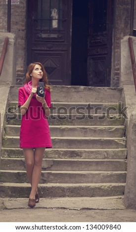 Young girl with vintage 6x6 camera at outdoor. - stock photo