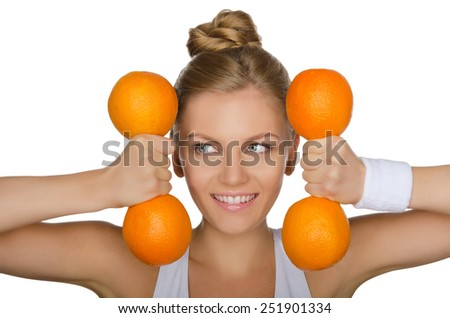 young girl with weights of ripe oranges looking away isolated on white - stock photo