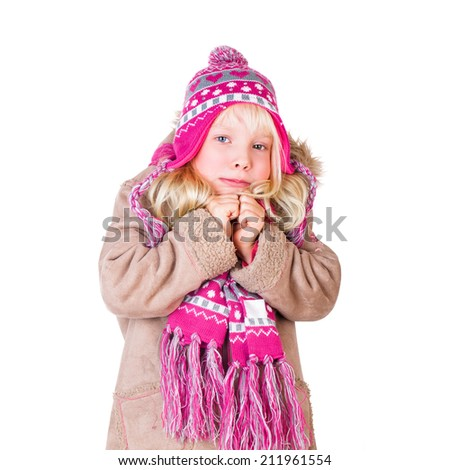 young girl with winter clothes on white background