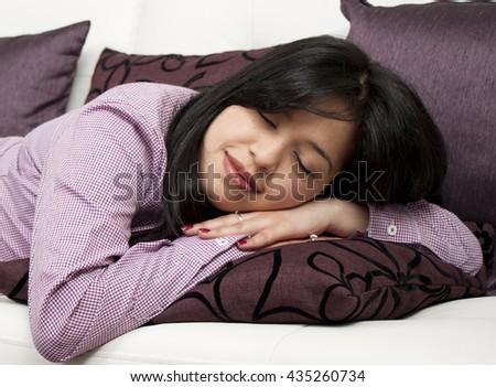 Young girl, woman sleeping on a sofa - stock photo