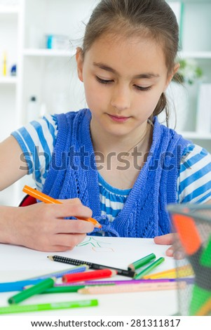 young girl working on her school project at home