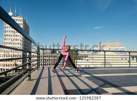 young girl workout on top of the building