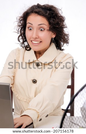 young girl works behind a computer at office - stock photo
