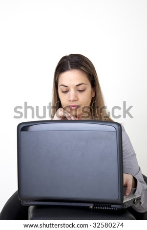 Young girl, writes in her computer