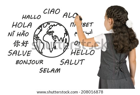 "Young girl writes on white board the word ""Hello"" - stock photo"