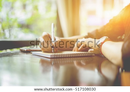 young girl writing into her diary about recipient address on mailing envelope,female hands sending letter,vintage color