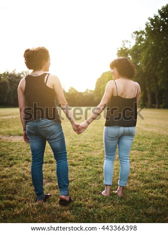 Young girlfriends at the park - stock photo