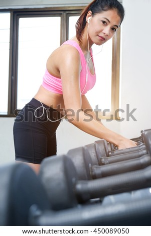Young girls doing exercise in fitness center , soft focus