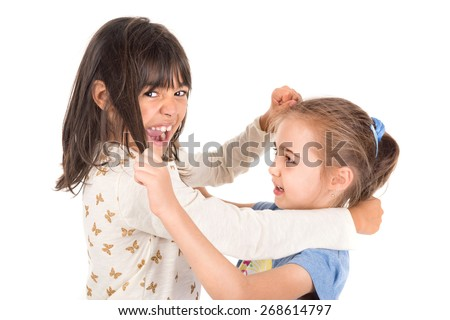 Young girls fighting, pulling hairs isolated in white