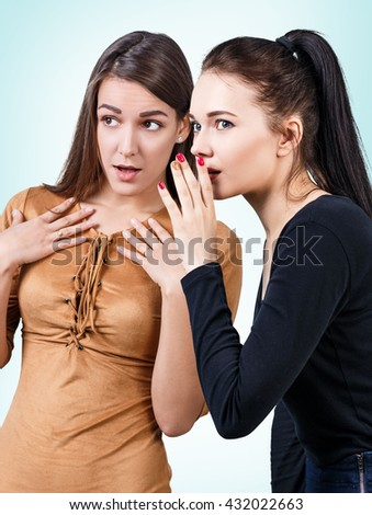 Young girls gossiping some secret