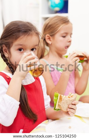 Young girls having a healthy snack - stock photo
