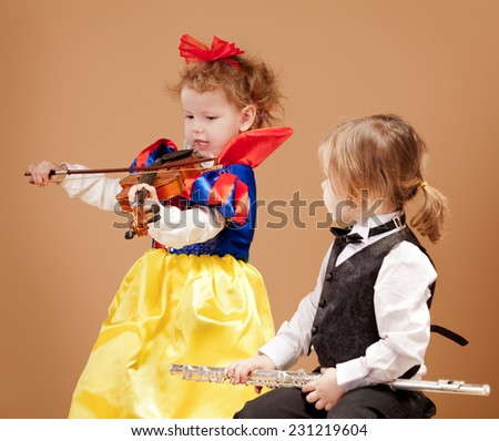 Young girls holding musical Instruments - stock photo