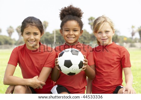 Young Girls In Football Team - stock photo