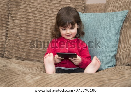 Young girls learning by watching tablet - stock photo