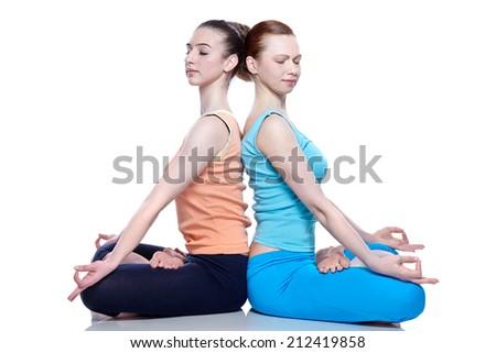 young girls meditating - stock photo