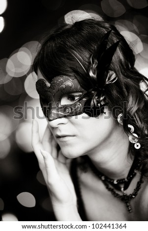 young girls portrait with venetian mask - stock photo
