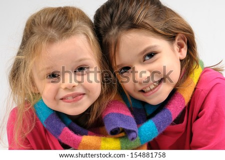 Young girls posing isolated in white