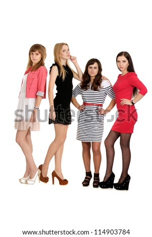 young girls posing on light background - stock photo