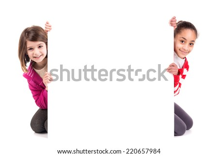 Young girls posing with a white board