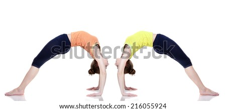 young girls practicing yoga on white background - stock photo