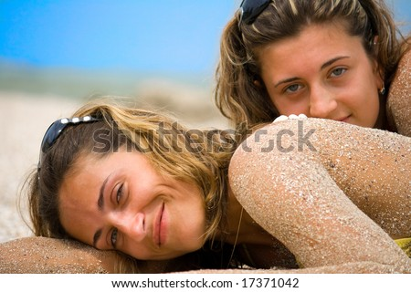 young girls, sunbathing by the sea