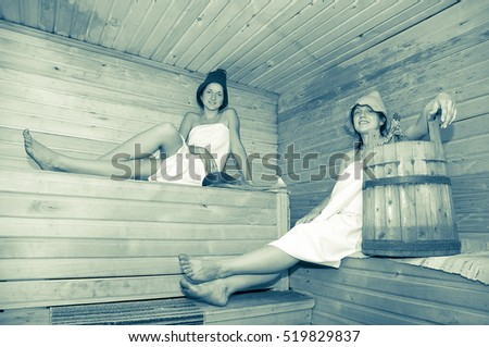 Young girls taking steam bath at sauna