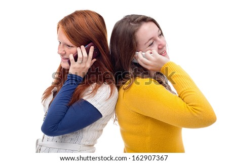 Young girls talking on mobile phone, isolated