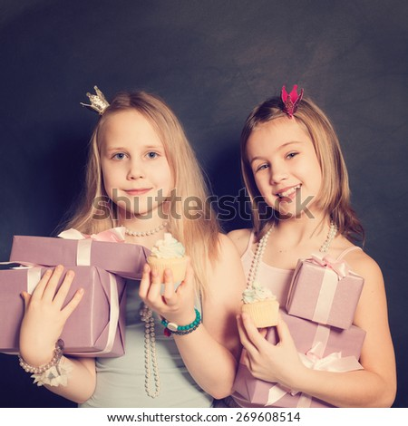 Young girls with gift box - stock photo