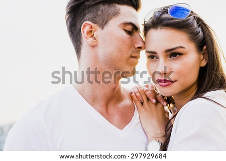 Young glamorous couple expressing sensuality and togetherness - stock photo