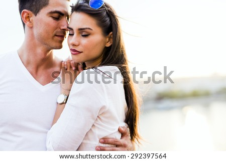 Young glamorous couple expressing sensuality with eyes closed - stock photo