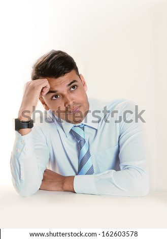Young good looking business Man thinking doubtful and pensive  isolated on clear background - stock photo