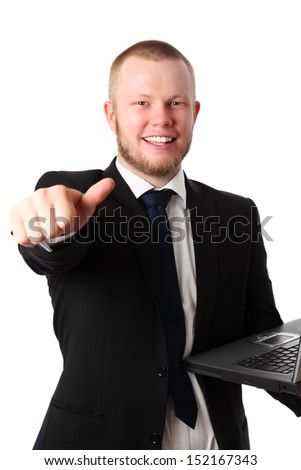 Young good looking businessman with a laptop, wearing a suit and tie doing thumbs up. White background.