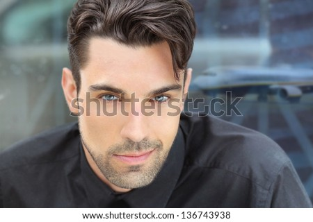Young good-looking male model with airport background - stock photo