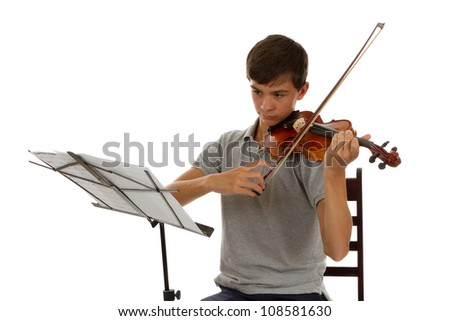 young good looking sitting reading sheet music playing the Viola