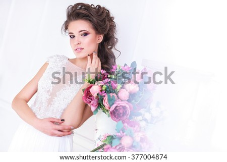 Young gorgeous bride with flowers. Close-up portrait