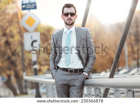 Young gorgeous businessman posing. Portrait of a good looking man, outdoor outside - stock photo