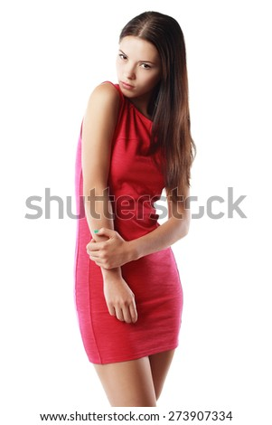 Young gorgeous caucasian brunette in red dress posing over grey background - stock photo