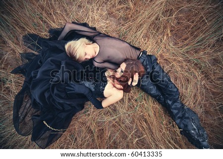 Young goth couple outdoors. Camera top view. - stock photo