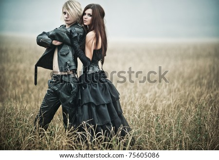Young goth couple outdoors portrait. - stock photo