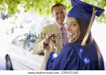 Young Graduate Getting a New Car From Her Father - stock photo