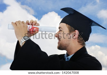 Young graduate student holding a diploma isolated with copy space - stock photo