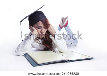 Young graduation girl with book - stock photo